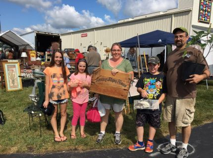 Family showing off their bought items from the 2017 Shipshewana Antique Festival