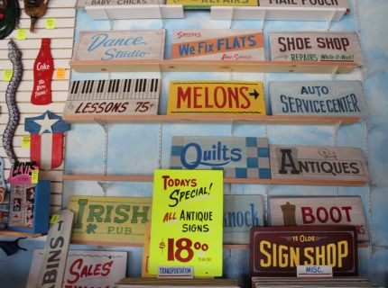 Signs for sale at George the Sign Painters booth at Shipshewana Flea Market