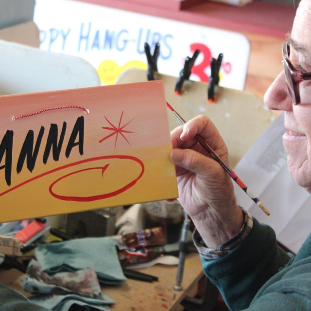 George the Sign Painter with a personalized Anna sign at Shipshewana Flea Market