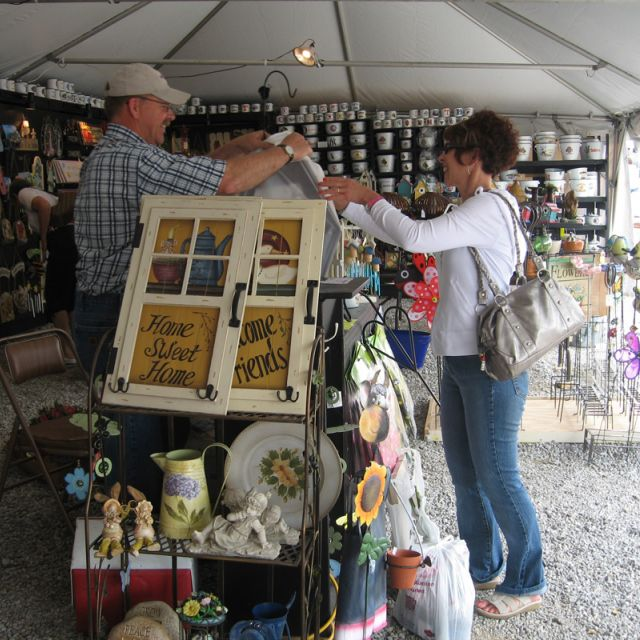 Happy vendor and happy shopper doing a transaction at Shipshewana Flea Market