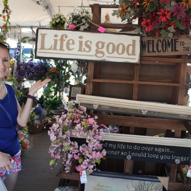Girl with life is good sign at flea market in Shipshewana Indiana