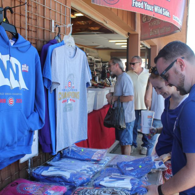 Couple browsing sports t-shirts at flea market in Shipshewana Indiana