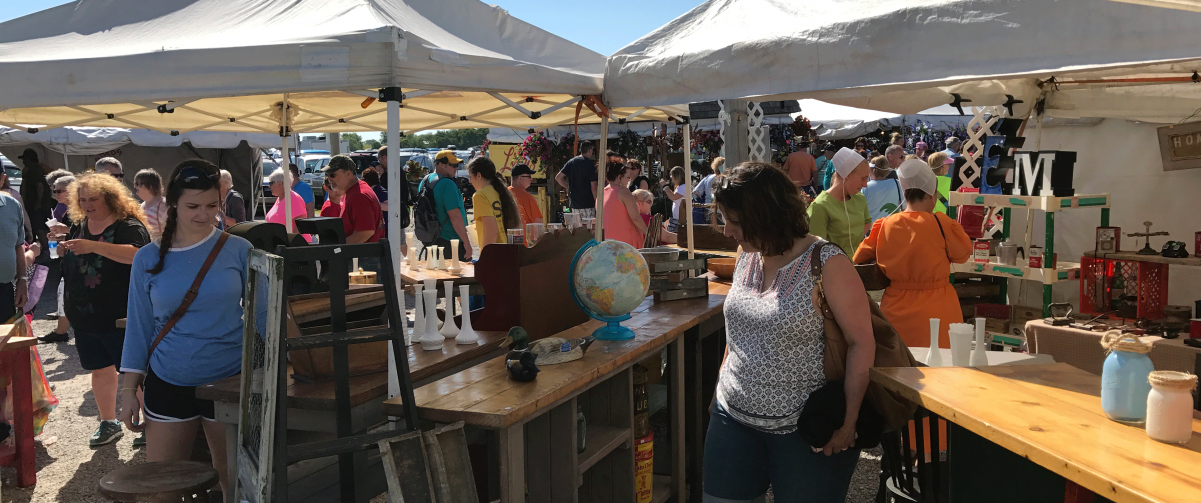 Shoppers looking at furniture at Shipshewana Flea Market