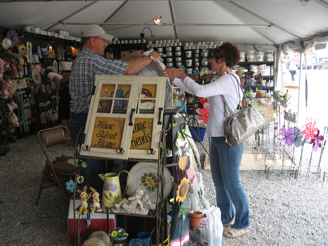Hy Vendor And Per Doing A Transaction At Shipshewana Flea Market